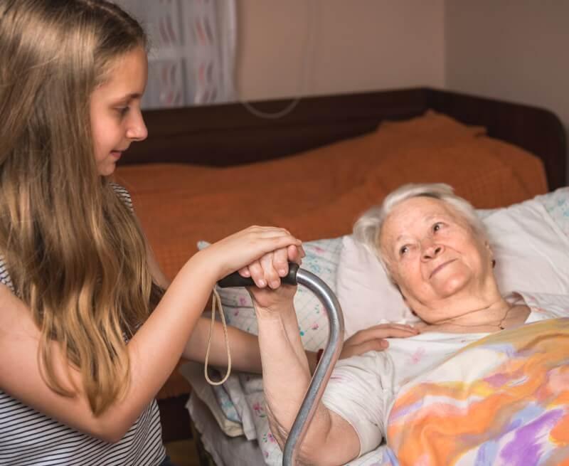 Grundpflege: Alte Dame im Bett